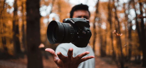 How to Make Money Selling Photographs Online - man with camera