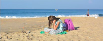 make money selling books online - reading on beach