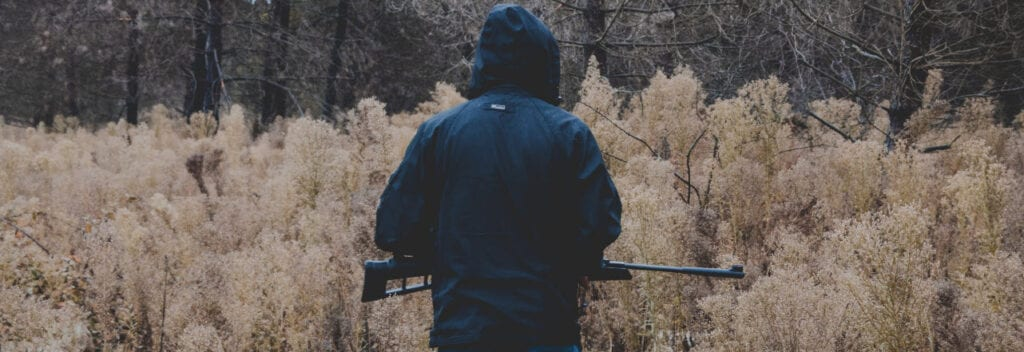Sell hunting gear online - hunter with gun