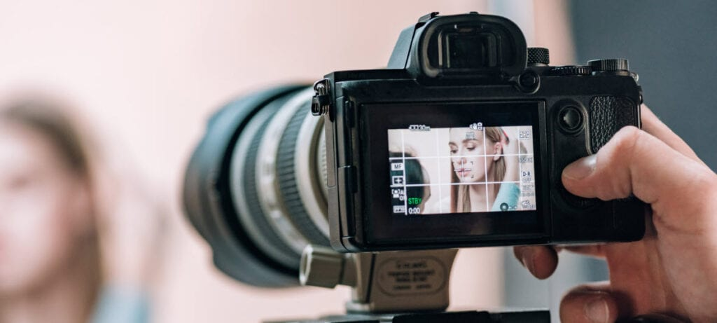 How To Monetize a Photography Blog - girl in camera